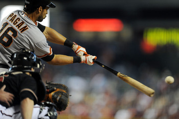 PHOENIX, AZ - SEPTEMBER 16:  Angel Pagan #16 of the San Francisco Giants drives the ball to the outfield against the Arizona Diamondbacks at Chase Field on September 16, 2012 in Phoenix, Arizona.  (Photo by Norm Hall/Getty Images)