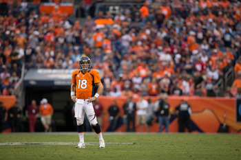 DENVER, CO - SEPTEMBER 23: Quarterback Peyton Manning #18 of the Denver Broncos facts on the field during a game against the Houston Texans at Sports Authority Field at Mile High on September 23, 2012 in Denver, Colorado. The Texans defeated the Broncos 3