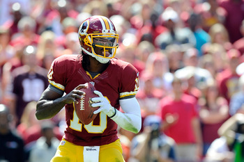 LANDOVER, MD - SEPTEMBER 23:   Robert Griffin III #10 of the Washington Redskins drops back to pass against the Cincinnati Bengals during a game at FedExField on September 23, 2012 in Landover, Maryland.  (Photo by Patrick McDermott/Getty Images)