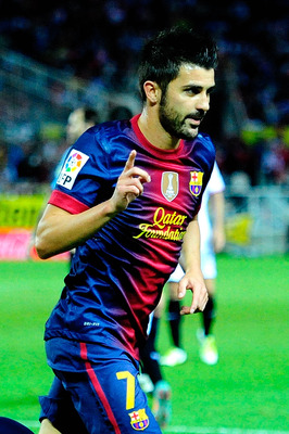 Villa celebrates his late winner against Sevilla.