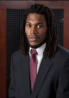 Goshockers.com/Carl Hall's dreads are an extension of his game