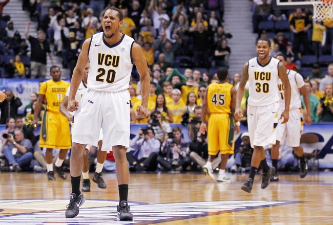 March 4, 2012; Richmond, VA USA; Virginia Commonwealth Rams guard/forward Bradford Burgess (20) celebrates after making a basket against the George Mason Patriots in the first half of their semifinal game of the 2012 Colonial Athletic Association Tourname