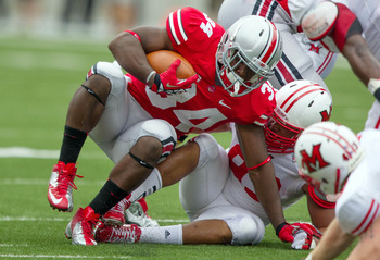Sept 1, 2012; Columbus, OH, USA; Ohio State Buckeyes running back Carlos Hyde (34) is tackled by Miami Redhawks defensive end Jason Semmes(93) during the first quarter of the game at Ohio Stadium. Mandatory Credit: Rob Leifheit-US PRESSWIRE