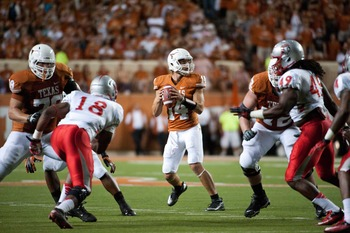 Longhorns offensive line protects quarterback David Ash.