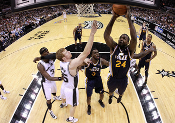 SAN ANTONIO, TX - APRIL 29: Paul Millsap #24 of the Utah Jazz takes a shot against the San Antonio Spurs in Game One of the Western Conference Quarterfinals in the 2012 NBA Playoffs at AT&T Center on April 29, 2012 in San Antonio, Texas.  NOTE TO USER: Us