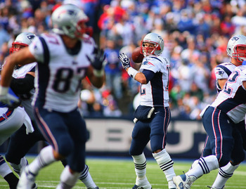 ORCHARD PARK, NY - SEPTEMBER 30:  Tom Brady #12 of the New England Patriots throws to  Rob Gronkowski #87 at Ralph Wilson Stadium on September 30, 2012 in Orchard Park, New York. Gronkowski scored a touchdown on the play.New England won 52-28.  (Photo by
