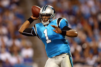CHARLOTTE, NC - SEPTEMBER 20:  Cam Newton #1 of the Carolina Panthers throws a pass against the New York Giants at Bank of America Stadium on September 20, 2012 in Charlotte, North Carolina.  (Photo by Streeter Lecka/Getty Images)
