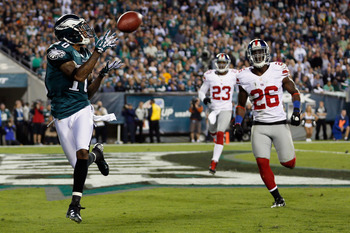 PHILADELPHIA, PA - SEPTEMBER 30:  Wide receiver DeSean Jackson #10 of the Philadelphia Eagles catches a touchdown pass in front of free safety Antrel Rolle #26 of the New York Giants during the second quarter at Lincoln Financial Field on September 30, 20