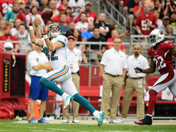 Hartline gets behind the coverage to reel in a touchdown pass.