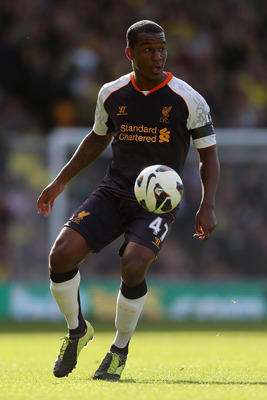 NORWICH, ENGLAND - SEPTEMBER 29:  Andre Wisdom of Liverpool in action during the Barclays Premier League match between Norwich City and Liverpool at Carrow Road on September 29, 2012 in Norwich, England.  (Photo by Julian Finney/Getty Images)