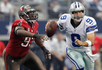 Gerald McCoy applying pressure on Tony Romo.