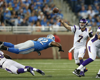 DETROIT, MI - SEPTEMBER 30:  Christian Ponder #7 of the Minnesota Vikings passes the football as he takes pressure from Cliff Avril #92 of the Detroit Lions chases at Ford Field on September 30, 2012 in Detroit, Michigan.  (Photo by Leon Halip/Getty Image