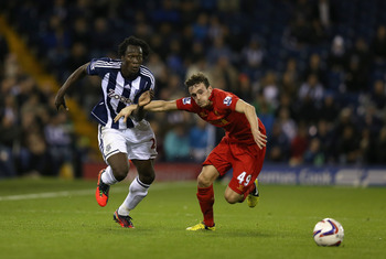 WEST BROMWICH, ENGLAND - SEPTEMBER 26:  Romelu Lukaku of West Brom holds off Jack Robinson of Liverpool during the Capital One Cup third round match between West Bromwich Albion and Liverpool at The Hawthorns on September 26, 2012 in West Bromwich, Englan