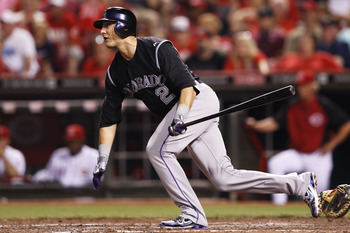 Troy Tulowitzki eyeing down a base-hit in a game against the Reds in May.