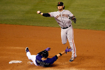 Gonzalez attempting to break up a double-play against Giants' shortstop Brandon Crawford.