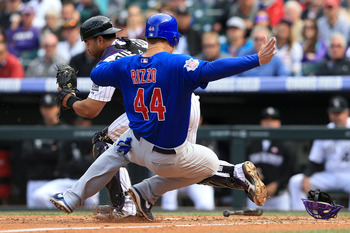 Rosario tries to stop Cubs 1B Anthony Rizzo from picking up a run.