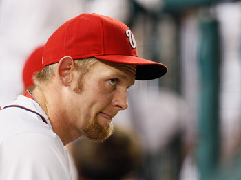 Stephen Strasburg looks on from the dugout during a Sept. 4 game against the Chicago Cubs