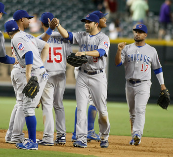 PHOENIX, AZ - SEPTEMBER 30:  David DeJesus #9 of the Chicago Cubs celebrates with teammates Luis Valbuena #24, Starlin Castro #13, Darwin Barney #15 and David Sappelt #17 following their 7-2 victory over the Arizona Diamondbacks during a MLB game at Chase