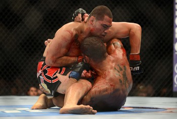 May 26, 2012; Las Vegas, NV, USA; Antonio Silva (bottom) and Cain Velasquez (top) fight during UFC 146 at the MGM Grand Garden event center. Mandatory Credit: Ron Chenoy-US PRESSWIRE