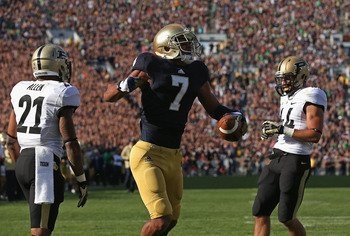 T.J. Jones celebrates a touchdown grab against Purdue earlier this season.