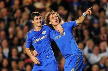 Oscar (left) scored both of Chelsea's goals in a 2-2 draw.