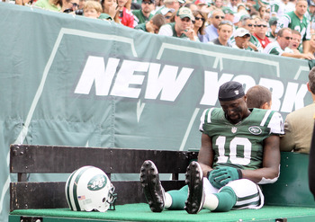 EAST RUTHERFORD, NJ - SEPTEMBER 30:  Santonio Holmes #10 of the New York Jets is carted off the field in the second half against the San Francisco 49ers on September 30, 2012 at MetLife Stadium in East Rutherford, New Jersey.The San Francisco 49ers defeat