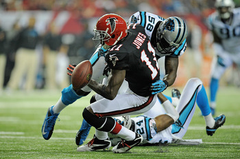 Thomas Davis (58) separates Falcons receiver Julio Jones from the ball.