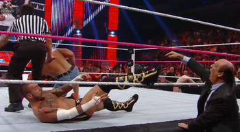 [Image: cm_punk_foot_on_ropes_wwe_raw_display_im...1349826113]