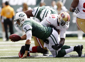 Jets QB Mark Sanchez gets sacked on Sunday in a shutout loss against San Francisco