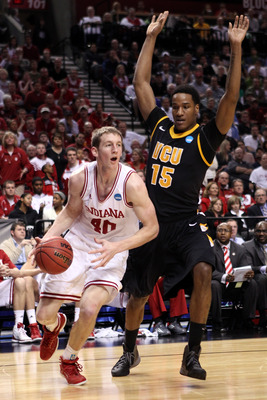 PORTLAND, OR - MARCH 17:  Cody Zeller #40 of the Indiana Hoosiers drives on Juvonte Reddic #15 of the Virginia Commonwealth Rams in the second half during the third round of the 2012 NCAA Men's Basketball Tournament at the Rose Garden Arena on March 17, 2