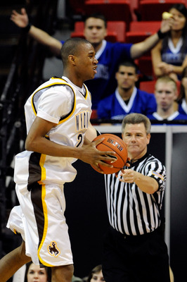 LAS VEGAS - MARCH 10:  Amath M'Baye #22 of the Wyoming Cowboys reacts as he is called for a foul against the Air Force Falcons during the first round of the Conoco Mountain West Conference Basketball tournament at the Thomas & Mack Center March 10, 2010 i