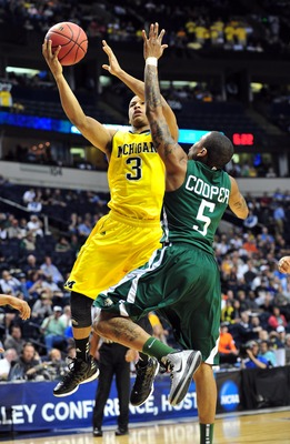 Mar 16, 2012; Nashville, TN, USA; Michigan Wolverines guard Trey Burke (3) shoots against the Ohio Bobcats guard D.J. Cooper (5) during the first half in the second round of the 2012 NCAA men's basketball tournament at Bridgestone Arena.  Mandatory Credit