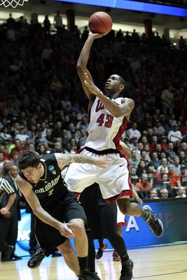 Mar 15, 2012; Albuquerque, NM, USA; UNLV Rebels forward Mike Moser (43) is called for a charge as Colorado Buffaloes guard Nate Tomlinson (1) defends during the first half in the second round of the 2012 NCAA men's basketball tournament at the Pit.  Manda