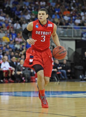 Mar 16, 2012; Omaha, NE, USA; Detroit Titans guard Ray McCallum (3) brings the ball up the court against the Kansas Jayhawks during the first half in the second round of the 2012 NCAA men's basketball tournament at the Century Link Center.  Mandatory Cred