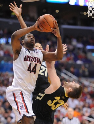 March 10, 2012; Los Angeles, CA, USA; Colorado Buffaloes forward Austin Dufault (33) fouls Arizona Wildcats forward Solomon Hill (44) as he shoots during the second half of the final round of the 2012 Pac 12 Tournament at the Staples Center. Mandatory Cre