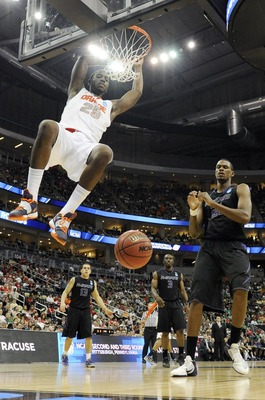 Mar 17, 2012; Pittsburgh, PA, USA; Syracuse Orange forward Rakeem Christmas (25) dunks the ball in the third round of the 2012 NCAA men's basketball tournament against the Kansas State Wildcats at the CONSOL Energy Center.  Mandatory Credit: Richard Macks