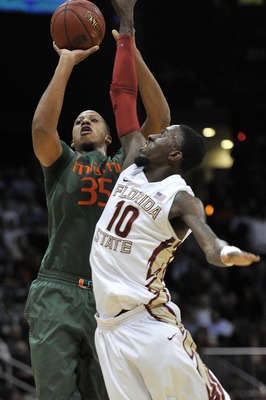 March 9, 2012; Atlanta, GA USA; Miami Hurricanes forward/center Kenny Kadji (35) shoots against the Florida State Seminoles forward Okaro White (10) during the first half of the quarter-finals of the 2012 ACC Men's Basketball Tournament at Philips Arena.