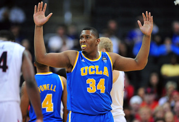 March 8, 2012; Los Angeles, CA, USA; UCLA Bruins center Joshua Smith (34) reacts to a foul called against him during the second round of the 2012 Pac 12 Tournament in the second half at Staples Center. Mandatory Credit: Gary A. Vasquez-US PRESSWIRE