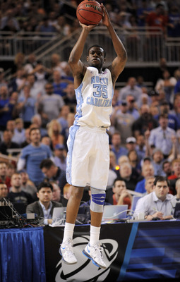 Mar 25, 2012; St. Louis, MO, USA; North Carolina Tar Heels guard Reggie Bullock (35) shoots during the first half of the finals of the midwest region of the 2012 NCAA men's basketball tournament against the Kansas Jayhawks at the Edward Jones Dome. Mandat