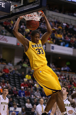 Mar 9, 2012; Indianapolis, IN, USA; Minnesota Golden Gophers forward Rodney Williams (33) dunks against the Michigan Wolverines during the first half of the second round of 2012 Big Ten Tournament at Bankers Life Fieldhouse.  Mandatory Credit: Brian Spurl