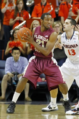 March 1, 2012; Charlottesville, VA USA; Florida State Seminoles guard Michael Snaer (21) holds the ball against the Virginia Cavaliers at John Paul Jones Arena. Mandatory Credit: Geoff Burke-US PRESSWIRE