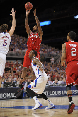 Mar 23, 2012; St. Louis, MO, USA; North Carolina State Wolfpack forward Richard Howell (1) shoots as he is defended by Kansas Jayhawks center Jeff Withey (5) during the first half of the semifinals in the midwest region of the 2012 NCAA men's basketball t