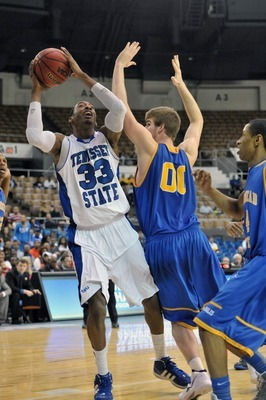Mar 3, 2012; Nashville,TN, USA; Tennessee State Tigers forward Robert Covington (33) shoots against Morehead State Eagles forward Drew Kelly (00) during the second half of the semifinals of the 2012 Ohio Valley Conference tournament at Municipal Auditoriu