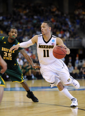 Mar 16, 2012; Omaha, NE, USA; Missouri Tigers guard Michael Dixon Jr. (11) drives against the Norfolk State Spartans during the second half in the second round of the 2012 NCAA men's basketball tournament at the Century Link Center.  Norfolk State won 86-