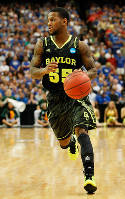 ATLANTA, GA - MARCH 25:  Pierre Jackson #55 of the Baylor Bears cintrols the ball against the Kentucky Wildcats during the 2012 NCAA Men's Basketball South Regional Final at the Georgia Dome on March 25, 2012 in Atlanta, Georgia.  (Photo by Kevin C. Cox/G