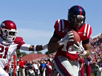 OXFORD,  MS - OCTOBER 22:   Donte Moncrief #12 of the Ole Miss Rebels catches a touchdown pass over Darius Winston #21 of the Arkansas Razorbacks at Vaught-Hemingway Stadium on October 22, 2011 in Oxford, Mississippi.  (Photo by Wesley Hitt/Getty Images)