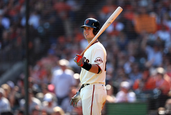 SAN FRANCISCO, CA - SEPTEMBER 27:  Buster Posey #28 of the San Francisco Giants waits to bat against the Arizona Diamondbacks at AT&T Park on September 27, 2012 in San Francisco, California.  (Photo by Ezra Shaw/Getty Images)