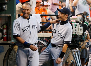 BALTIMORE, MD - SEPTEMBER 06: Derek Jeter #2 (L) and Ichiro Suzuki #31 of the New York Yankees joke around in the dugout before the start of the Yankees game against the Baltimore Orioles at Oriole Park at Camden Yards on September 6, 2012 in Baltimore, M