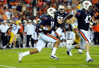 Sep 22, 2012; Auburn, AL, USA; Auburn Tigers quarterback Kiehl Frazier (10) runs the ball in the first half against the LSU Tigers at Jordan Hare Stadium. Mandatory Credit: Shanna Lockwood-US PRESSWIRE