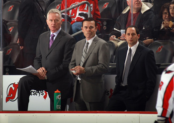 Capitals' new bench boss Adam Oates (center)